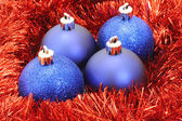Blue Christmas balls with red tinsel — Stock Photo