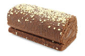 Chocolate Swiss roll closeup on a white background — Stock Photo