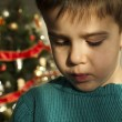 Unhappy child on Christmas — Stock Photo