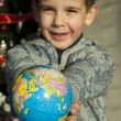 Child who give as gift the world — Stock Photo