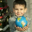 Stock Photo: Child who give as gift the world