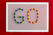 Go text.Colorful letters on mosaic. — Stock Photo
