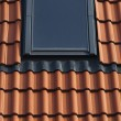Dormer on a tiled roof - Stock Photo