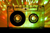 Transparent Cassette tape disco lights background — Stock Photo