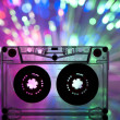 Cassette tape and multicolored lights - Stock Photo