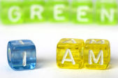 Text I am green on colorful cubes — Stock Photo