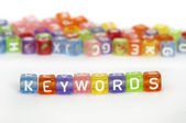 Text Keywords on colorful cubes — Stock Photo