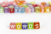 Text Words on colorful cubes over white — Stock Photo
