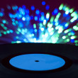 LP vinyl record and disco lights — Stock Photo
