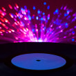 Stock Photo: LP vinyl record and disco lights