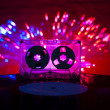 LP vinyl record, cassette tape and disco lights — Stock Photo