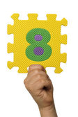 Children hand holding the number Eight. White isolated number — Stock Photo