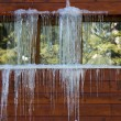 Icicles on window — Stock Photo #9193515