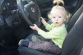 Baby girl driving — Stock Photo