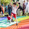 Little boy playing on the rainbow flag — Stock Photo