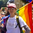 Young woman with rainbow flag at Pride Parade TA - Stock Photo