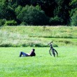 Byke rider resting on the countryside — Stock Photo