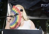 Female transgender with rainbow fan — Stock Photo