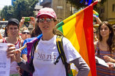 Young woman with rainbow flag at Pride Parade TA — Stock Photo