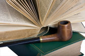 Two old books and a pipe — Stock Photo