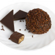 Chocolate ball and slices of chocolate bar — Stock Photo
