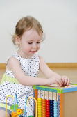 Little girl playing in a developing toy — Stock Photo