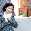 Portrait of a pretty girl with a scarf on the street — Foto Stock
