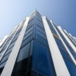 Office building under blue cloudless sky — Stock Photo