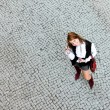 Portrait of pretty girl on the stone pavement. View from the top. - Stock Photo