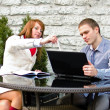 Business partners meeting: Male and female with laptop sitting outdoors — Stock Photo #10324456