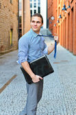 Young guy posing with a laptop on the street. — Stock Photo