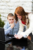 Business partners meeting: Male and female with laptop — Stockfoto