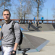 Portrait of BMX bicycle rider on urban skatepark background — Stock Photo