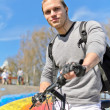 Portrait of BMX bicycle rider on urban skatepark background — Stock Photo #10410189