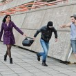 Stock Photo: Robbery prevention on street. Thief try to steal bag.