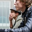 Tough guys. Portrait of two man standing on balcony — Stockfoto