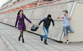 Robbery prevention on the street. Thief try to steal a bag. — Stock Photo