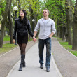 Couple walking down the road in the park. — Stock Photo #10542384
