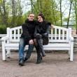 Portrait of happy couple on park bench. — Stock Photo