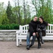 Royalty-Free Stock Photo: Portrait of happy couple on park bench.