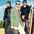 Royalty-Free Stock Photo: Mafia: Three thugs with a suitcase and weapons