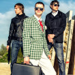 Mafia: Three thugs with a suitcase and weapons - Stock Photo