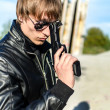 Portrait of man with a gun in glasses — Stock Photo