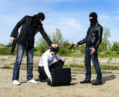 Two bandits kidnapped a businessman with a suitcase — Stock Photo