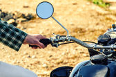 Man's hand rests on the steering wheel motorcycle — Stock Photo