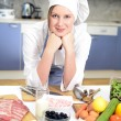 Stock Photo: Happy cook in the kitchen