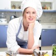 Happy cook in the kitchen — Stock Photo