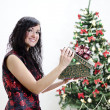 Christmas: brunette girl with gift — Stock Photo