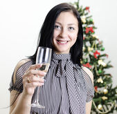 Christmas: girl congratulates with glass of wine — Foto de Stock