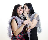 Two girls gossiping at the party — Stock Photo